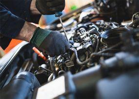 Unrecognizable auto mechanic work