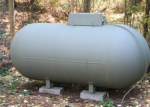 propane tank in leafy area